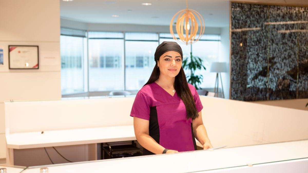 A photograph of a TRIO receptionist.