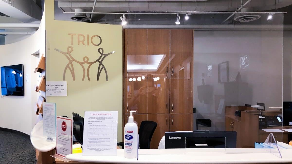 A photograph of the TRIO reception desk.
