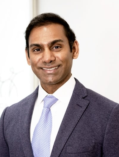 A photograph of Dr. Arnold Mahesan.